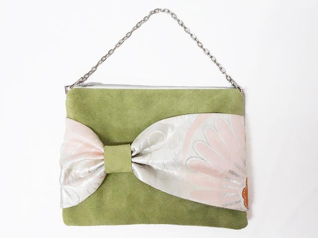 スウェードと帯のハンドバッグ